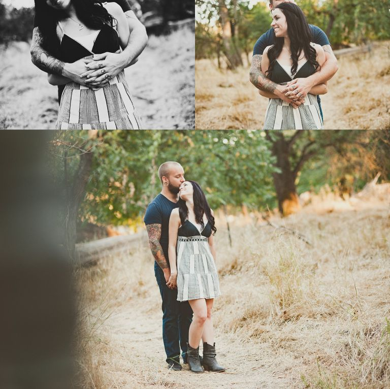 engaged couple hugging, she wearing a dress, he in tshirt and jeans