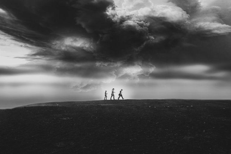 Three children clouds hiking a mountain