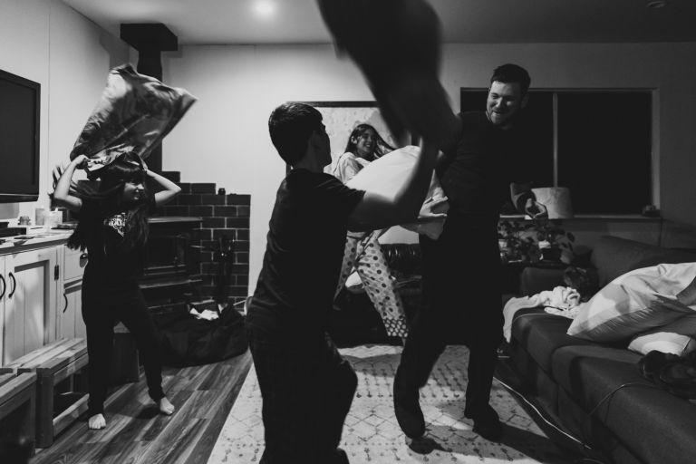 black and white photo family having fun
