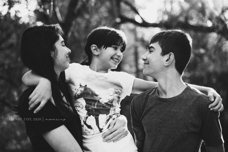 Black and white photo of three kids